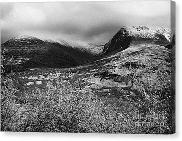 View Of The Summit Of Ben Nevis Snow Capped And Shrouded In Mist In Spring Near Fort William Scotlan Canvas Print by Joe Fox
