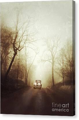 Vintage Car On Foggy Rural Road Canvas Print by Jill Battaglia