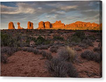 Warm Glow Over Arches Canvas Print by Andrew Soundarajan
