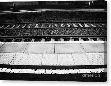 Warning Line And Textured Contoured Tiles Railway Station Platform And Track Northern Ireland Canvas Print by Joe Fox