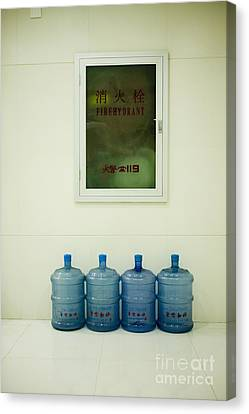 Water Cooler Bottles And Fire Hydrant Cabinet Canvas Print by Andersen Ross