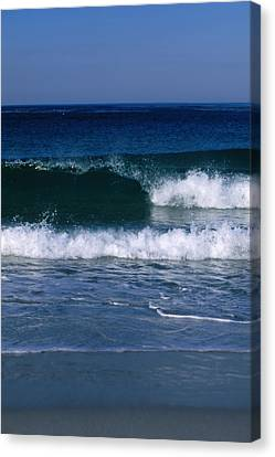 Wave Breaking Left On The Beach At 17 Canvas Print by James Forte