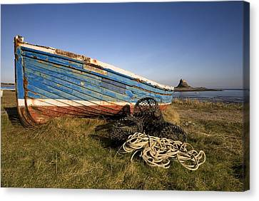 Weathered Fishing Boat On Shore, Holy Canvas Print by John Short