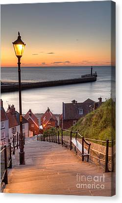 Whitby Steps - Orange Glow Canvas Print by Martin Williams