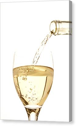 White Wine Pouring Into A Glass Canvas Print by Ross Durant Photography