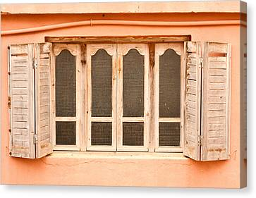 Window Shutter Canvas Print by Tom Gowanlock