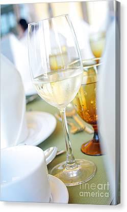 Wineglass Canvas Print by Atiketta Sangasaeng