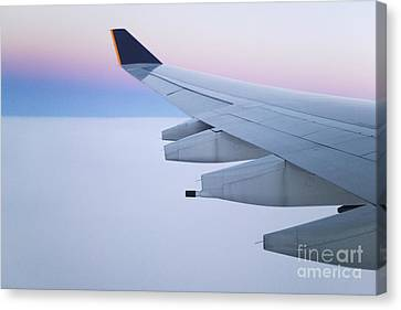 Wing And Engines Of Jet In Flight Canvas Print by Jeremy Woodhouse