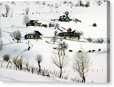 Winter In The Village Canvas Print by Emanuel Tanjala