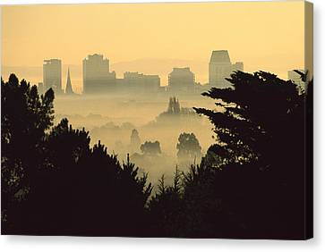 Winter Smog Over The City Canvas Print by Colin Monteath