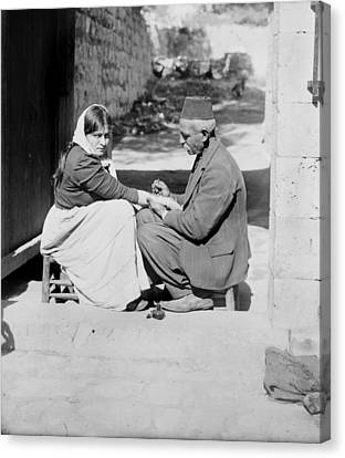 Woman Being Tattooed By A Man In A Fez Canvas Print by Everett