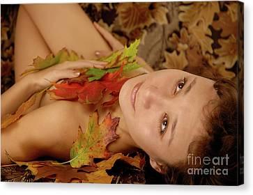 Woman In Fallen Leaves Canvas Print by Oleksiy Maksymenko