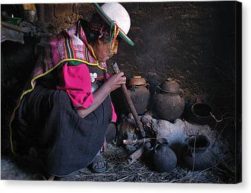 Woman Of Kallawaya Culture In Its Traditional Cuisine. Republic Of Bolivia. Canvas Print by Eric Bauer