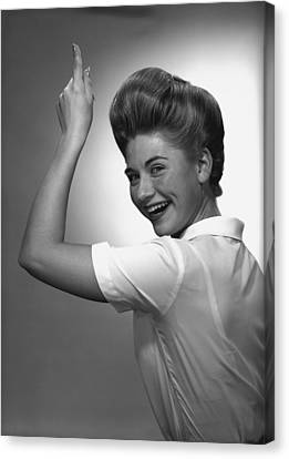 Woman Pointing Up In Studio, (b&w), Portrait Canvas Print by George Marks