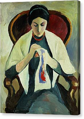 Woman Sewing Canvas Print by August Macke