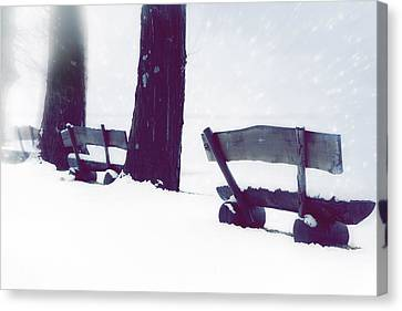 Wooden Benches In Snow Canvas Print by Joana Kruse