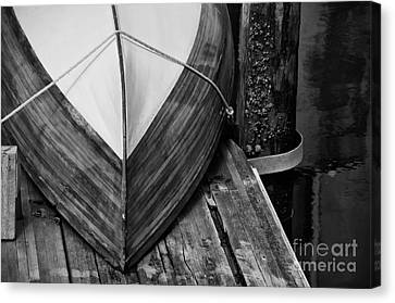 Wooden Boat On The Dock Canvas Print by Wilma  Birdwell