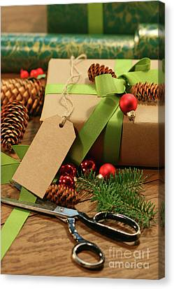 Wrapping Gifts For The Holidays Canvas Print by Sandra Cunningham