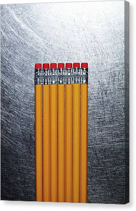 Yellow Pencils With Erasers On Stainless Steel. Canvas Print by Ballyscanlon