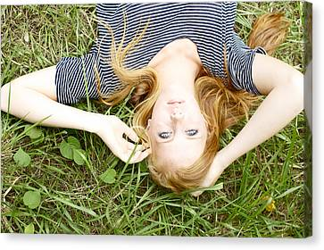 Young Girl On Grass Canvas Print by Kicka Witte