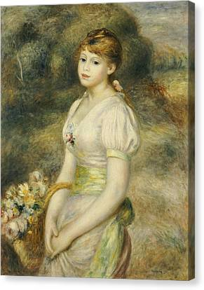 Young Girl With A Basket Of Flowers Canvas Print by Pierre Auguste Renoir