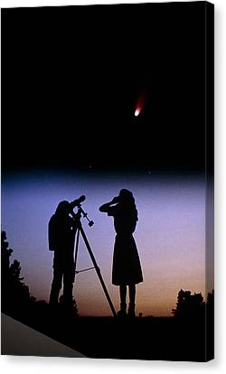 Young People Observe A Bright Comet Canvas Print by John Sanford