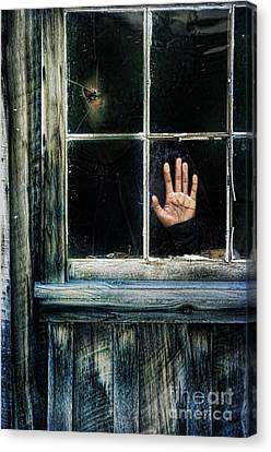 Young Woman Looking Through Hole In Window Canvas Print by Jill Battaglia