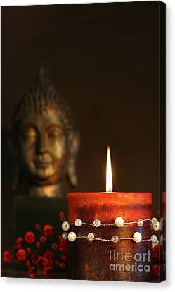 Zen Candle And Buddha Statue Canvas Print by Sandra Cunningham