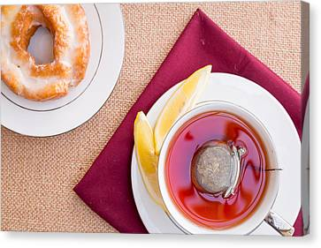 Breakfast With Pastries, And Hot Tea With Lemon #1 Canvas Print by Jon Manjeot
