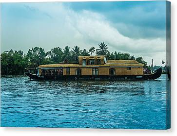 A House Boat Around The Backwaters In Alleppey, Kerala, India Canvas Print by Art Spectrum