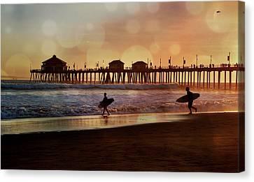 Huntington Beach Sunset Surfers Canvas Print by Debra Souter