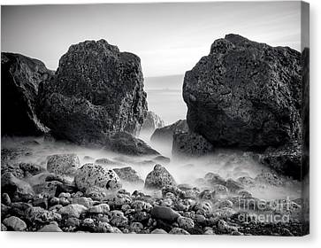 Waves And Rocks Canvas Print by Ray Pritchard