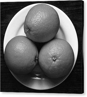Oranges On White Plate In Black And White Canvas Print by Donald Erickson