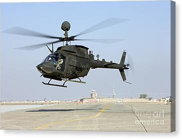 An Oh-58d Kiowa Warrior Hovers Canvas Print by Terry Moore
