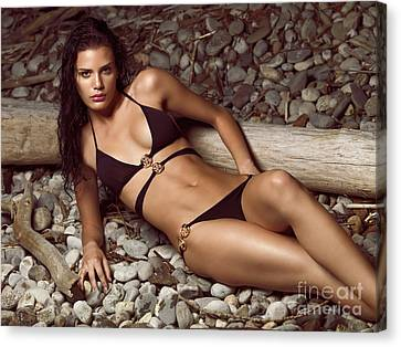 Beautiful Young Woman In Black Bikini On A Pebble Beach Canvas Print by Oleksiy Maksymenko