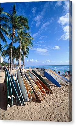 Colorful Surfboards On Waikiki Beach Canvas Print by George Oze