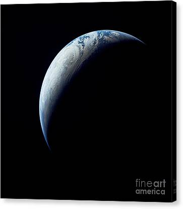 Crescent Earth Taken From The Apollo 4 Canvas Print by Stocktrek Images