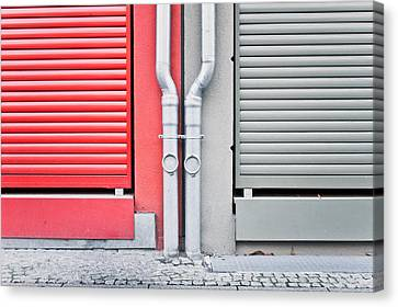 Drain Pipes Canvas Print by Tom Gowanlock
