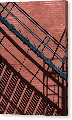 Fire Escape And Shadows Canvas Print by Robert Ullmann