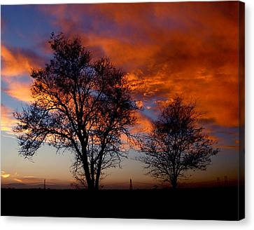 Fire In The Sky Canvas Print by Peter Piatt
