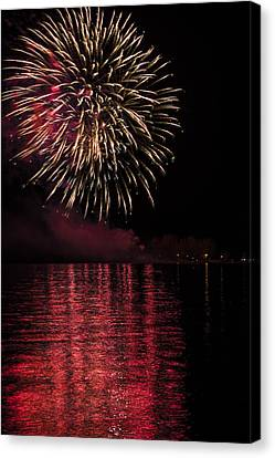Firework With Red Reflection In Water Canvas Print by Larysa Hlebik