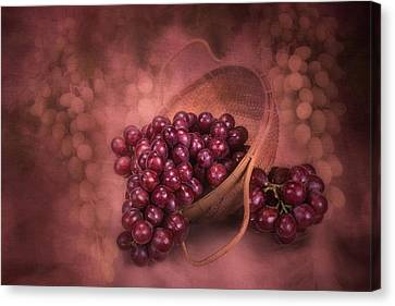 Grapes In Wicker Basket Canvas Print by Tom Mc Nemar