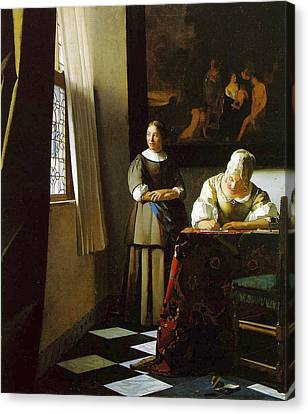 Lady Writing A Letter With Her Maid Canvas Print by Johannes Vermeer