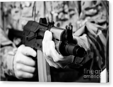 Man In Combat Fatigues Holding Aks-47u Close Quarter Combat Kalashnikov Rifle Canvas Print by Joe Fox