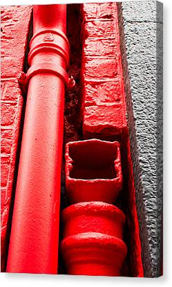 Red Drainpipe Canvas Print by Tom Gowanlock