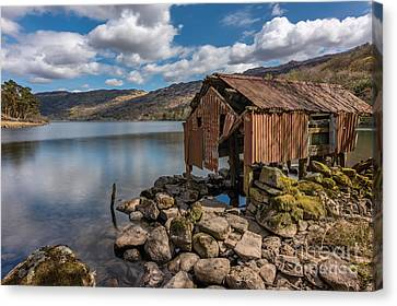 Rusty Boathouse Canvas Print by Adrian Evans