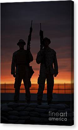 Silhouette Of U.s Marines On A Bunker Canvas Print by Terry Moore