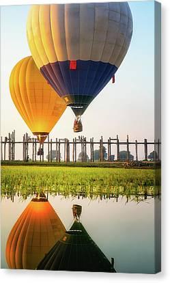 Sunrise At U Bein Bridge Canvas Print by Anek Suwannaphoom