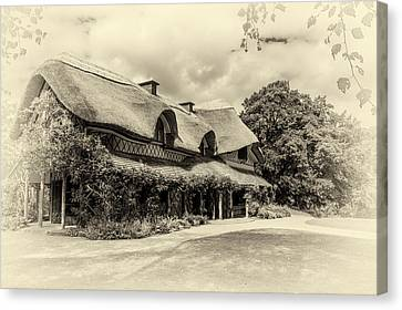 Swiss Cottage Canvas Print by Martina Fagan