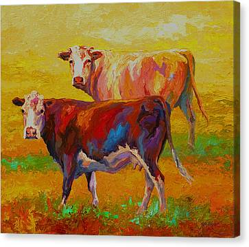 Two Cows Canvas Print by Marion Rose